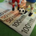 HAMBURG, GERMANY - FEBRUARY 06:  This photo illustration shows Euro bank notes and a table soccer game on February 6, 2013 in Hamburg, Germany. Europol have uncovered evidence that hundreds of football matches were subject to corruption leaving more than 400 officials and players under suspicion of involvement.  (Photo by Stuart Franklin/Bongarts/Getty Images)